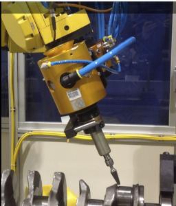 רובוט FANUC מבצע הורדת גרד - צילוע